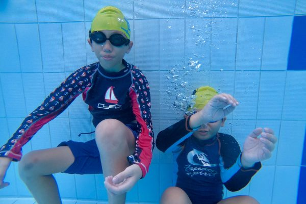 children learn underwater during swimming lessons singapore